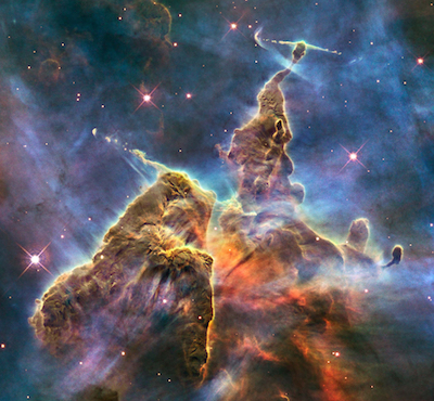 """Mystic Mountain,"" a detail from the much more extensive Carina Nebula, which astronomers are studying the complicated physical processes that form new stars. Photo by  NASA, ESA, and M. Livio and the Hubble 20th Anniversary Team (STScI)"
