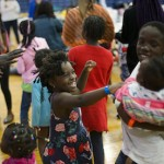 Children dance to music after lunch Wednesday at the Portland (Maine) Expo. Photo by Derek Davis / Portland Press Herald