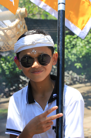 Boy in a funeral procession; the Balinese do not mind strangers witnessing their ceremonies, and funerals are a big celebration. Karma and dharma are a strong part of their Hindu beliefs. Photo by Amanda Painter.
