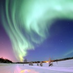 Aurora Borealis, or northern lights, shines above Bear Lake, Alaska. Photo by Senior Airman Joshua Strang, U.S. Air Force, via Wikimedia Commons.
